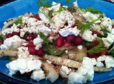 Fennel salad with pomegranate seeds, feta and sumac